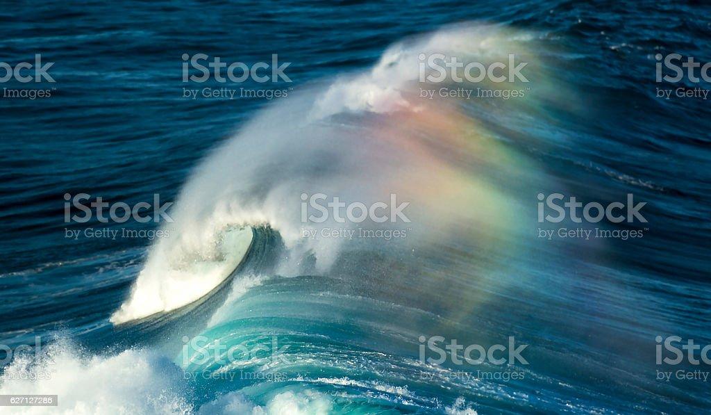 Rainbow over the waves stock photo