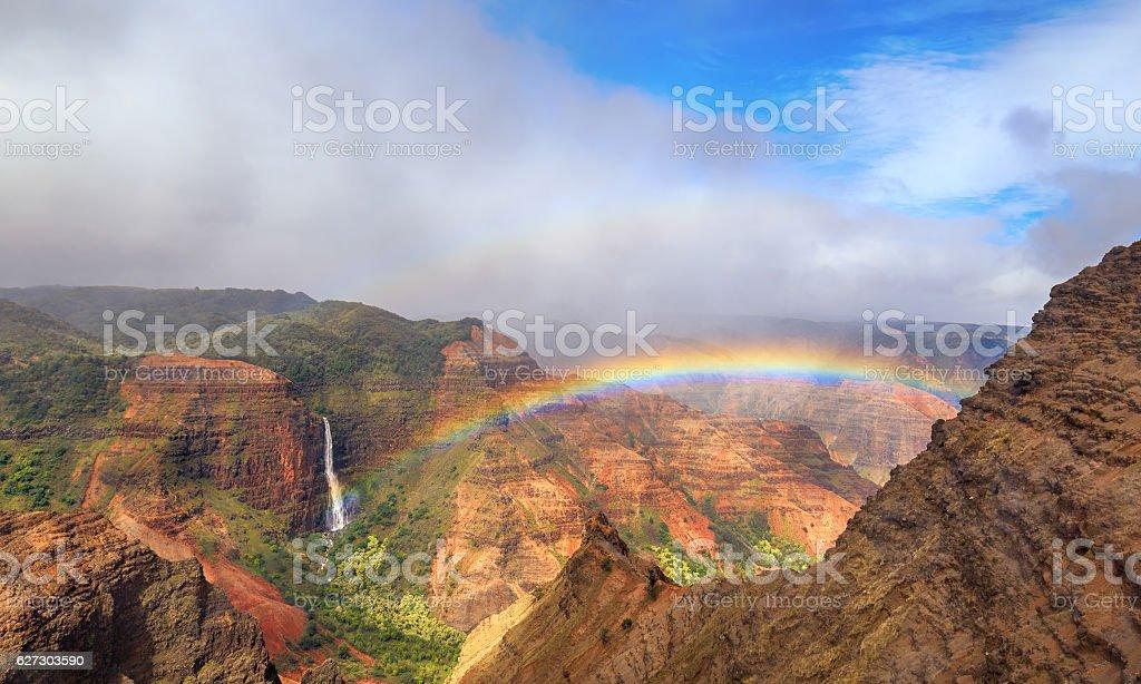 Rainbow over Waimea Canyon in Kauai stock photo
