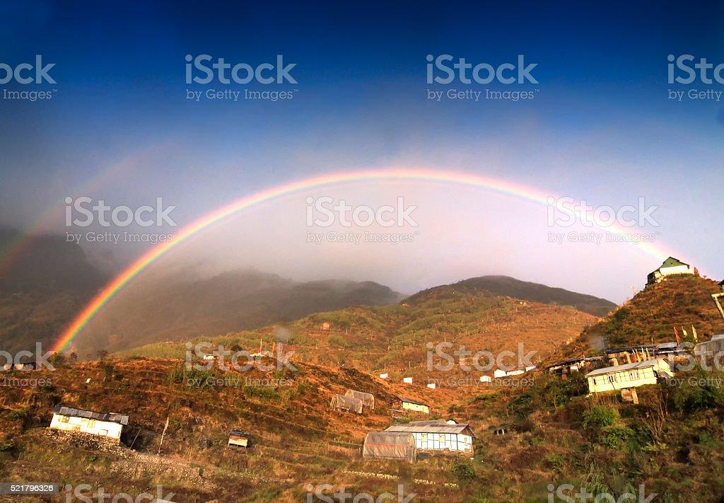 Rainbow over Zuluk village, Sikkim, India stock photo