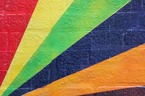 A close up macro shot of diagonal colored lines radiating on an old brick wall in Columbus, OH