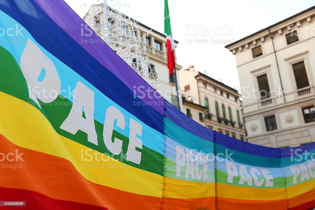 rainbow peace flag during a demonstration of peace activists in stock photo