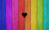 Colorful plank wall with heart shape in the middle.