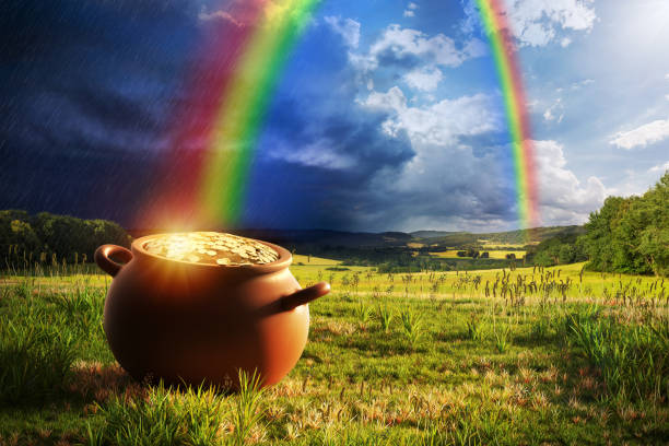 Rainbow Pot of Gold Pot full of gold at the end of the rainbow. pot of gold stock pictures, royalty-free photos & images