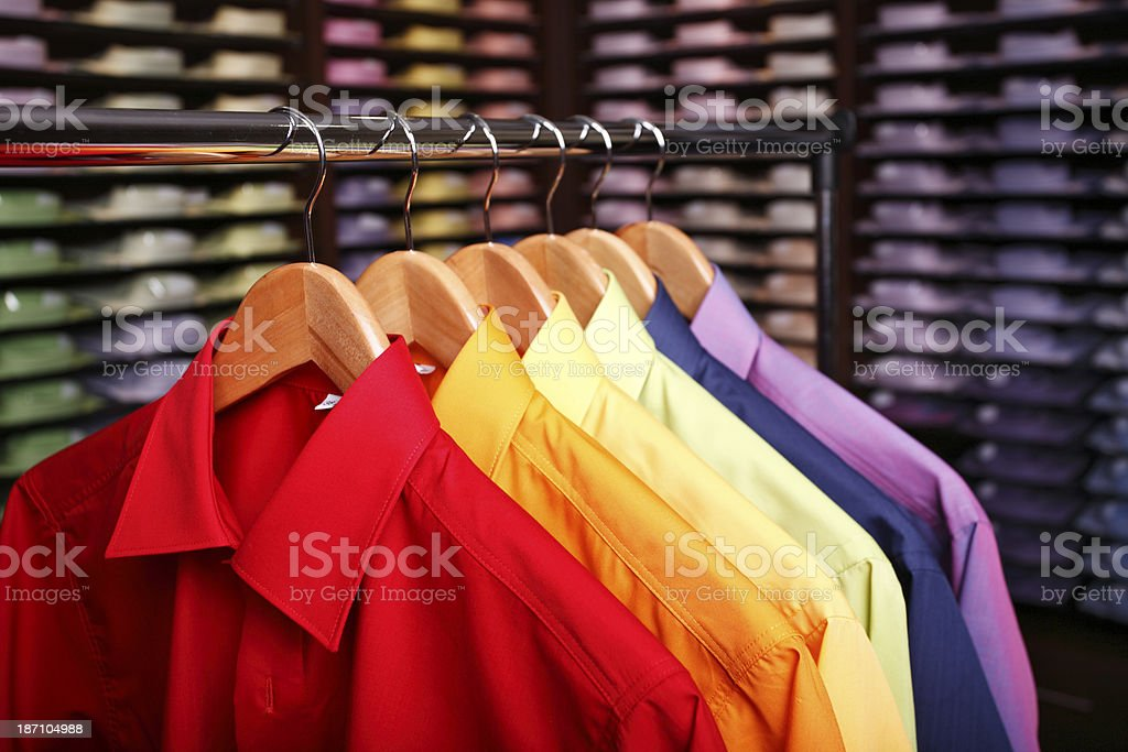 Rainbow shirts in a store stock photo