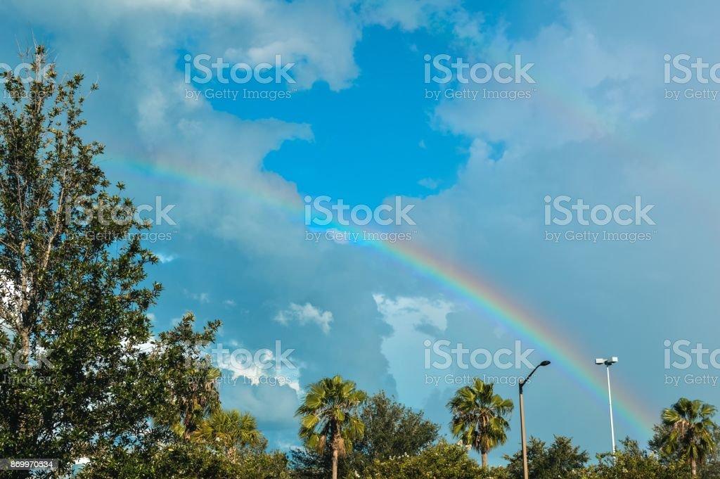 Rainbow sky in double line on blue vivid sunny sky
