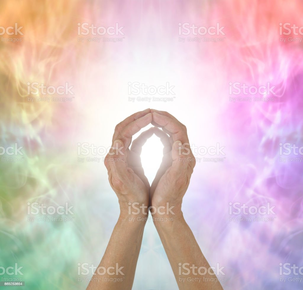 Rainbow Spectrum Energy healing hands stock photo