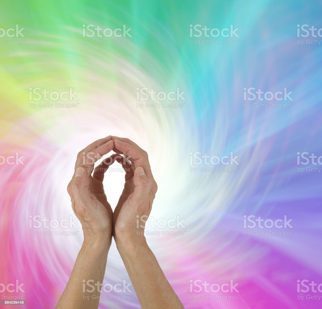 Rainbow Spiral Energy healing hands stock photo