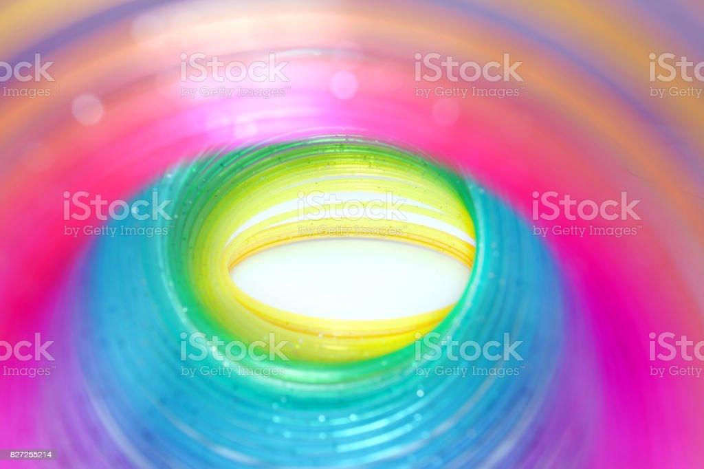rainbow spring toy on isolated white background stock photo