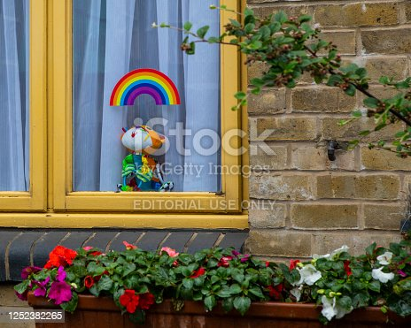 London, UK - June 17th 2020: Rainbow sticker and cuddly toy in the window of a house in London, UK.  During the Coronavirus pandemic, the rainbow has become a symbol of gratitude, hope and solidarity.