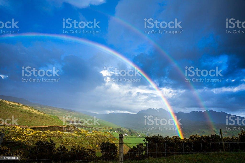 Rainbow sunlight on golden landscape Isle of Skye Scotland stock photo