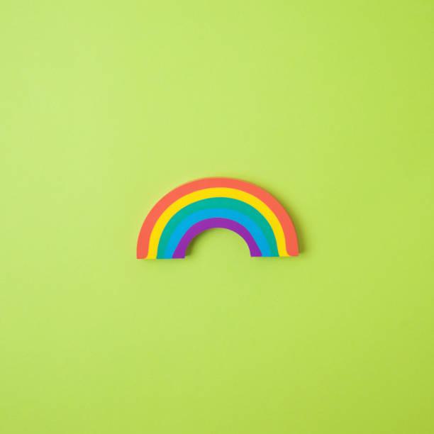 Rainbow symbol over green background. Concept of hope during coronavirus COVID-19 pandemic stock photo