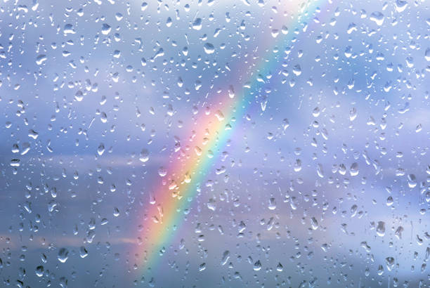 rainbow through a window with drops after storm - deszcz zdjęcia i obrazy z banku zdjęć