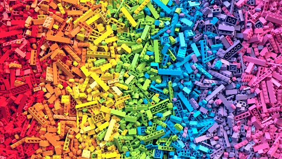 Pile of raindow toy blocks background. 3D Rendering