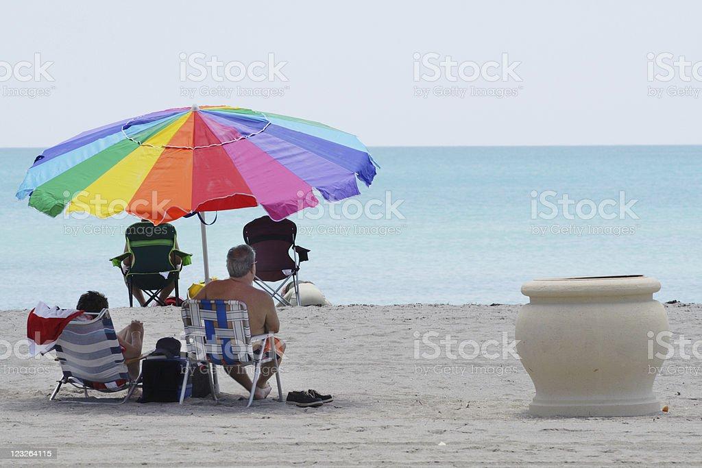 Rainbow Umbrella on the Beach royalty-free stock photo