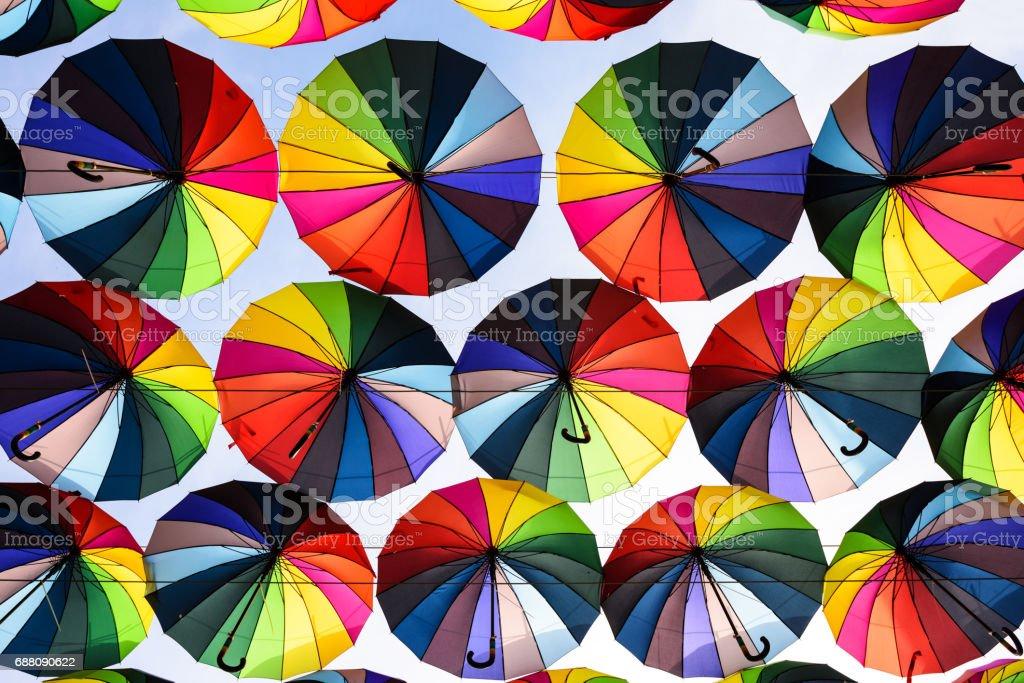 Rainbow umbrella above the street, LGBT symbols.