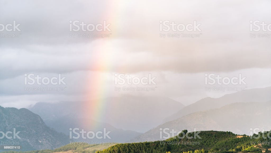 Rainbow Under Mountains At The Rain Beautiful Natural Landscape Stock Photo Download Image Now Istock