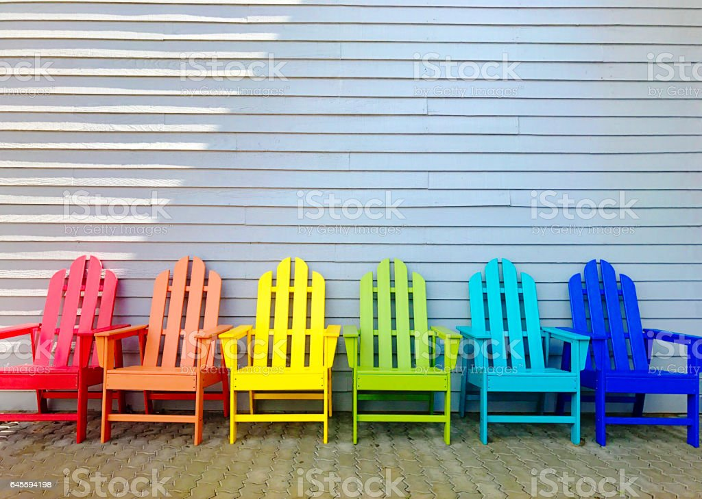 Rainbow Vacation Adirondack Chairs in Patio stock photo