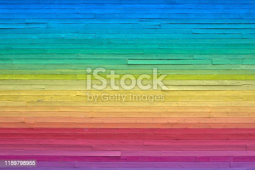 Building siding painted in rainbow colors.