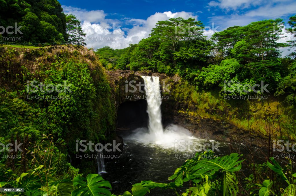 Rainbow waterfall Hawaii stock photo