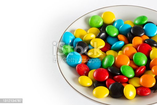 istock Rainbow-colored candies, multicolored close-up, texture, background. 1312134787