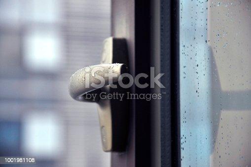 Raindrop on window with Handle