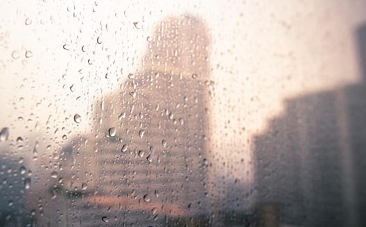 Raindrops and blurred Bangkok city background