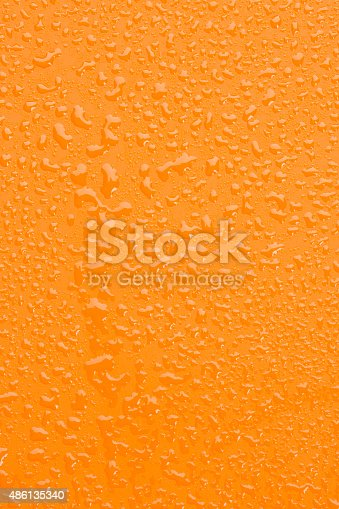 Raindrops background. Close up. Ice cold,  Orange surface covered with water drops condensation texture.