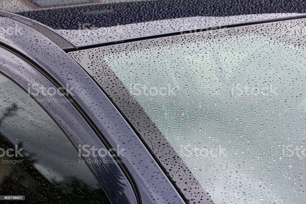 raindrops on a car stock photo