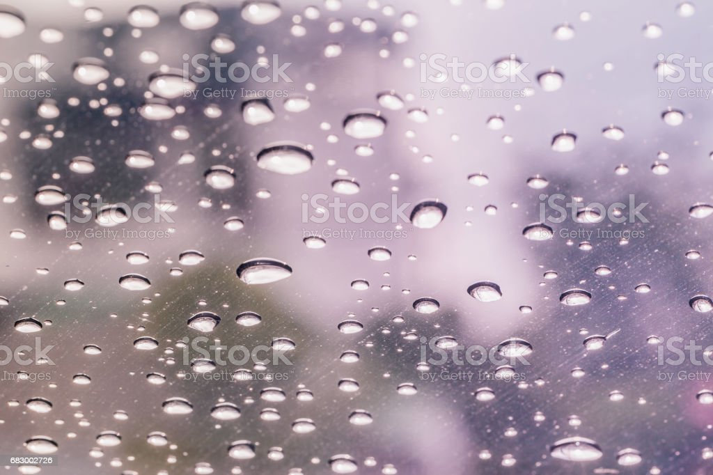 Raindrops on a car windshield after raining, raining season royalty-free stock photo
