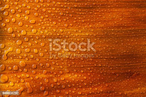 Equal pattern of raindrops on a lacquered wooden table