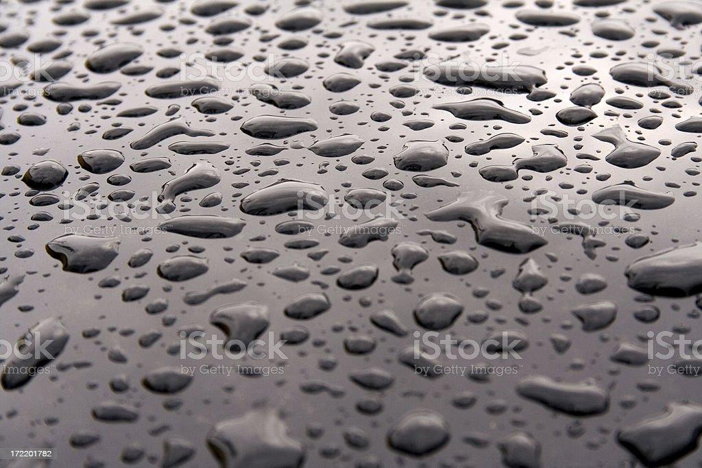Raindrops on car stock photo