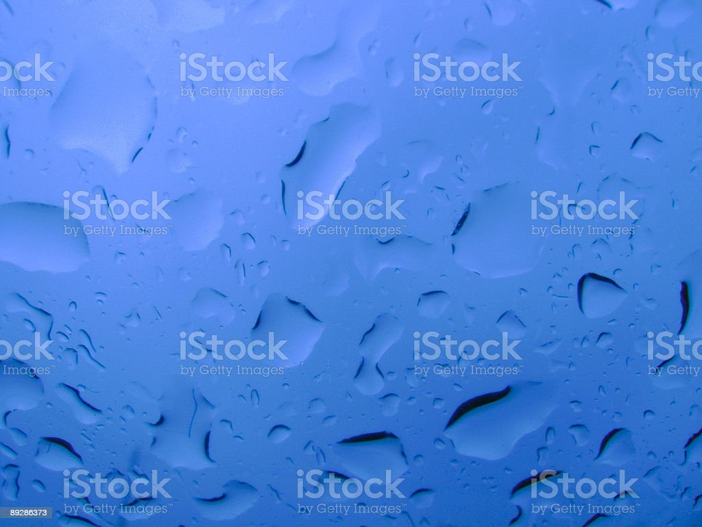 Raindrops on glass from underneath royalty-free stock photo