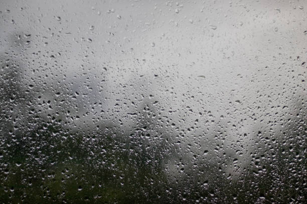 raindrops on the window - view out the window outwards stock photo