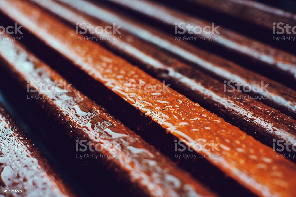 Raindrops on the wooden planks, soft-focus stock photo