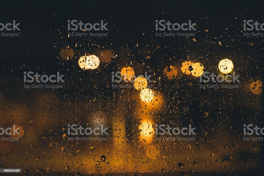 Raindrops on Window at Night stock photo
