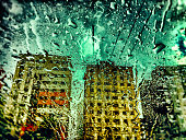 Raindrops on windshield and three skyscrapers on rain. Taken by Iphone 6. Post processing with Lightroom, Photoshop and Nick Software.