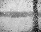 istock Raindrops on windshield with blurred background,horizontal 476700164