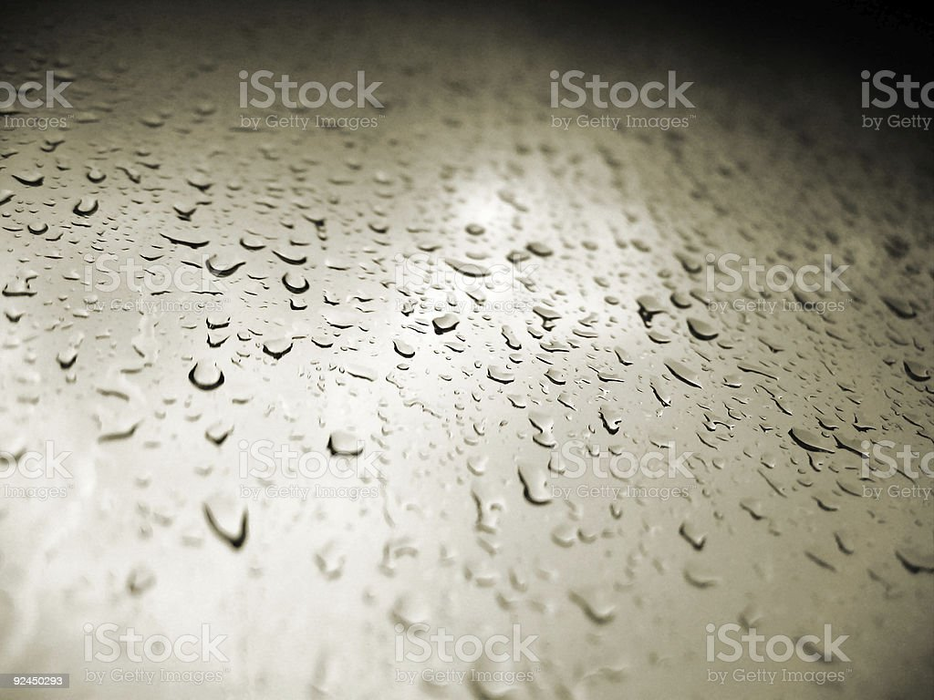 Raindrops running down window stock photo