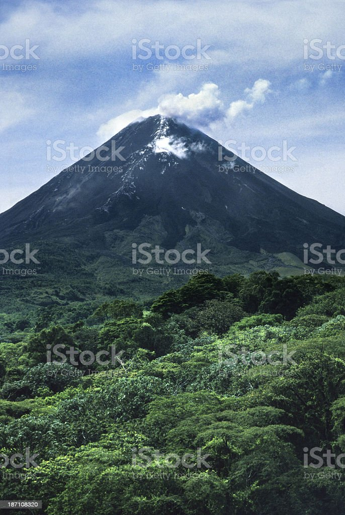 Rainforest and smoking Arenal Volcano Costa Rica stock photo