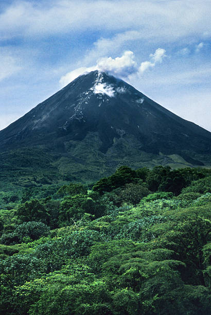 Rainforest and smoking Arenal Volcano Costa Rica stock photo