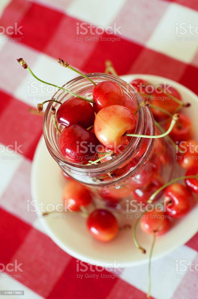 Rainier cherries in a glass can stock photo
