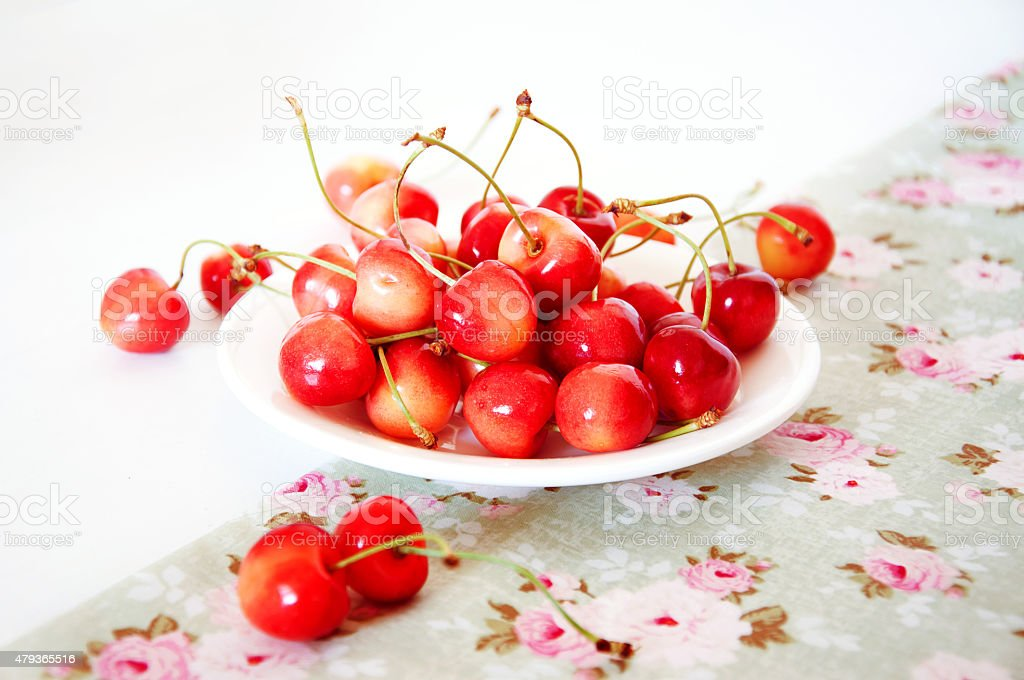 Rainier cherries on a white plate stock photo