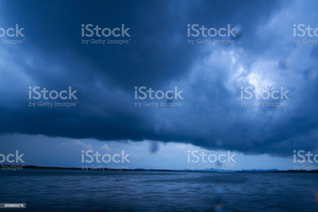 raining cloud over the sea