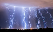 Lots of lightning raining down on the City of Tucson during a summer monsoon storm.