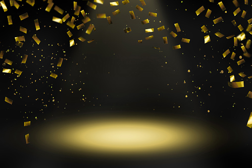 istock raining gold confetti in spotlight 1045529896
