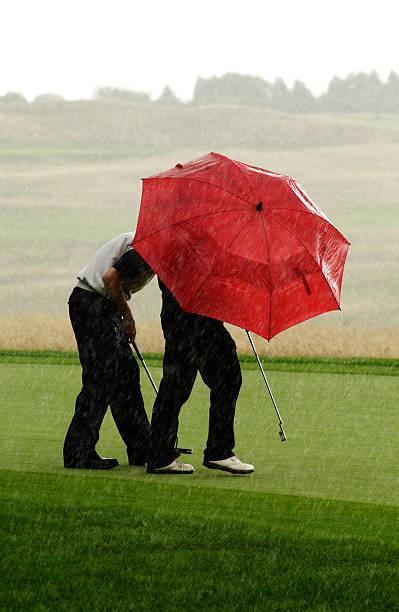 Raining Golf Umbrellas stock photo
