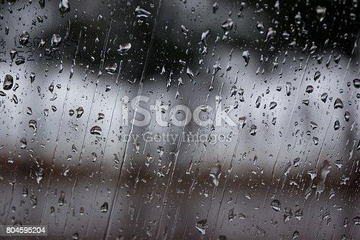 Rain drop on car glass close up background.