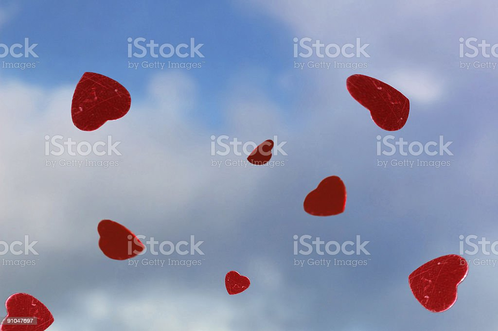 Raining red hearts stock photo