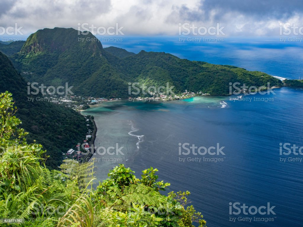 Rainmaker Mountain and Aua Village, American Samoa stock photo
