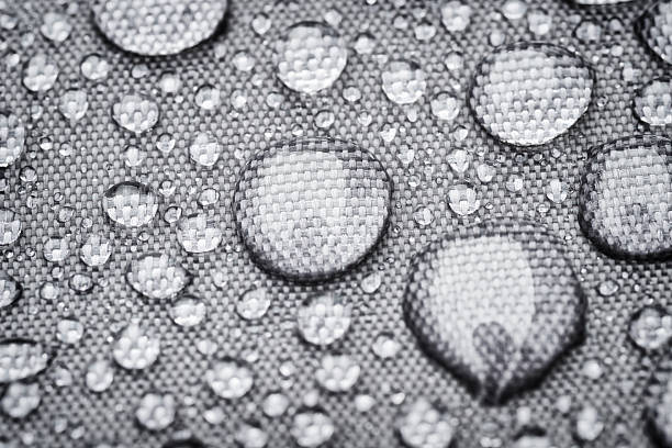 rainproof cloth with raindrops rainproof cloth with raindrops waterproof clothing stock pictures, royalty-free photos & images